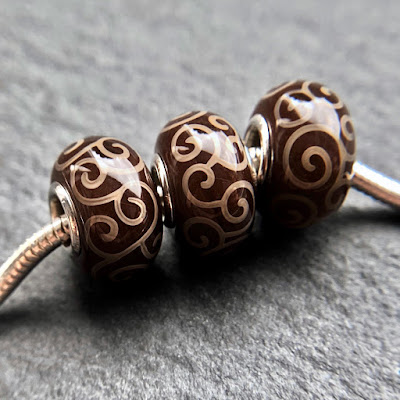 Handmade lampwork silver core big hole charm beads by Laura Sparling made with CiM Chocolate