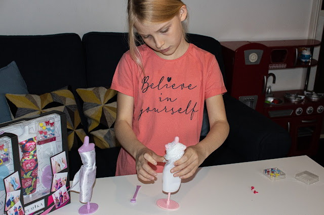 A girl creating a dress design on a Harumika mannequin