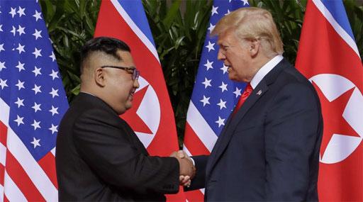 kim-donald-handshake-512.jpg