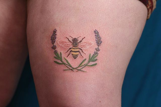 small lavender sprig tattoo with bee