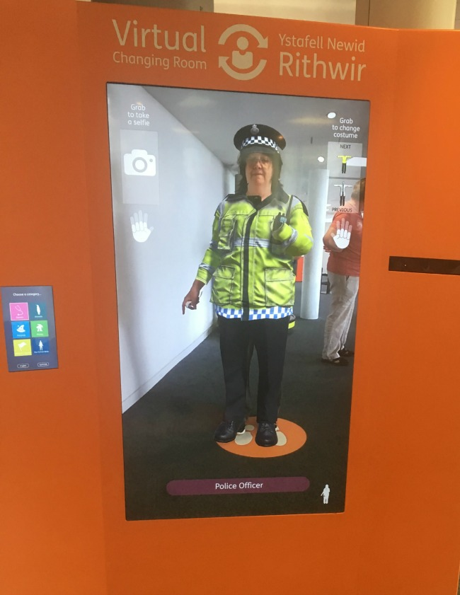 Techniquest-Virtual-Reality-changing-room-a-toddler-explores-a-police-woman