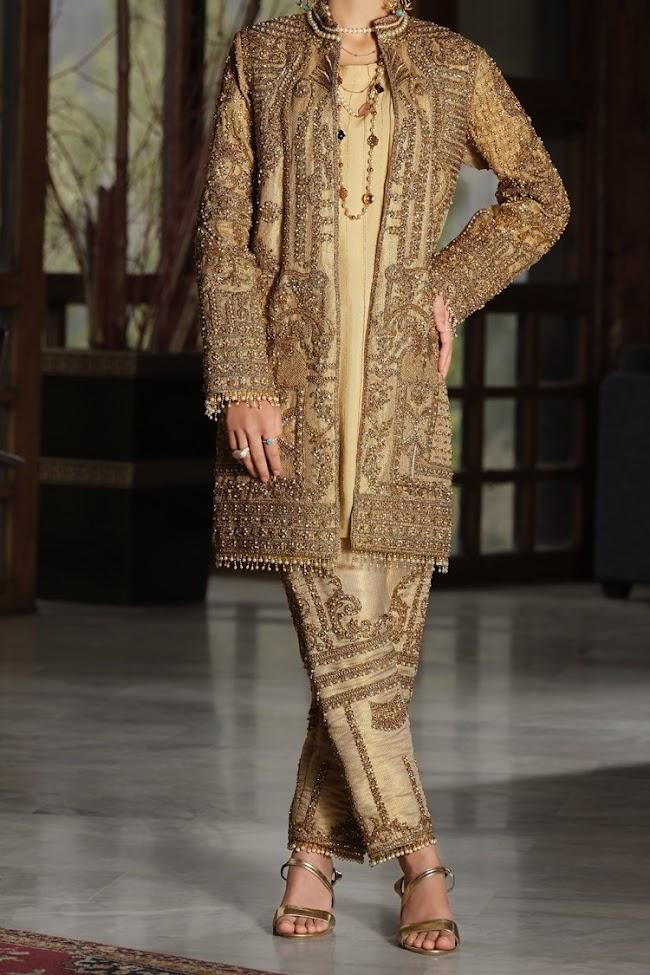 Almirah golden color jamawar suits Formal collection.