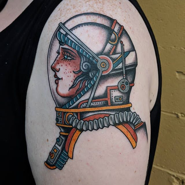 girl astronaut halmet tattoo