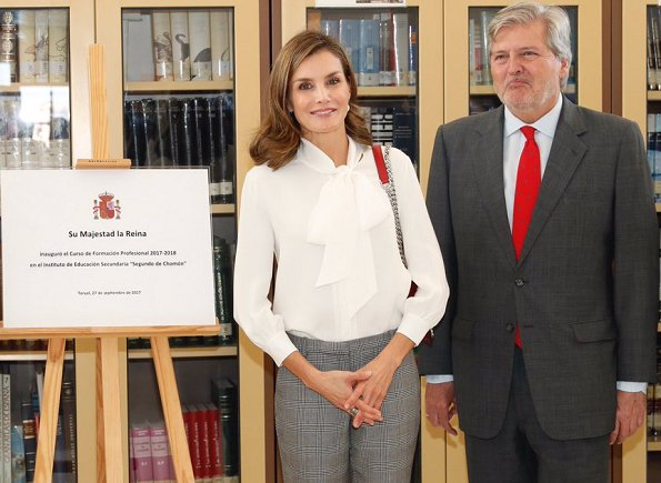 Queen Letizia wore Zara silk blouse, Mango Prince of Wales trouser and carried Zara Laser Cut Leather Crossbody Bag