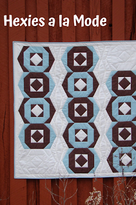 Brow and turquoise fabrics are perfect for this Hexies a la Mode quilt