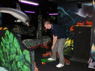 Richard Gottfried playing on the Search for Atlantis indoor Mini Golf course at Castleford's Xscape centre
