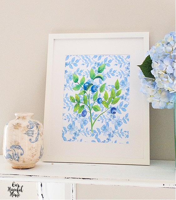 blueberry botanical print white frame blue white vase blue hydrangeas