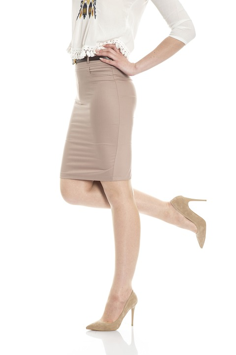 A DIY Reviver to Invigorate Tired Legs and Feet lower part of woman's body in skirt and heels
