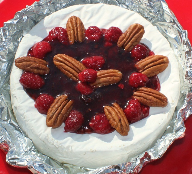 this is baked brie with fresh raspberries and pecans