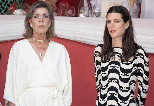 Princess Caroline wore a new wide short sleeve wrap front jumpsuit from Halston. Charlotte Casiraghi wore a new silk crepe dress from Chanel