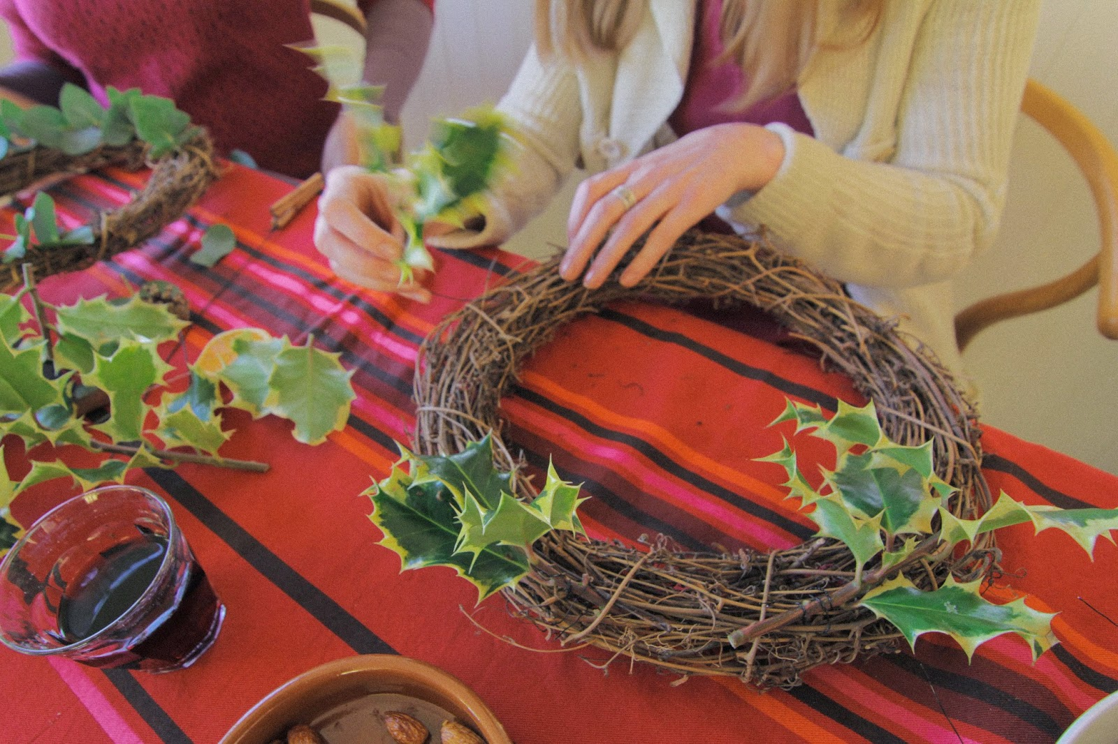 How to make a Christmas wreath - place greenery at regular intervals