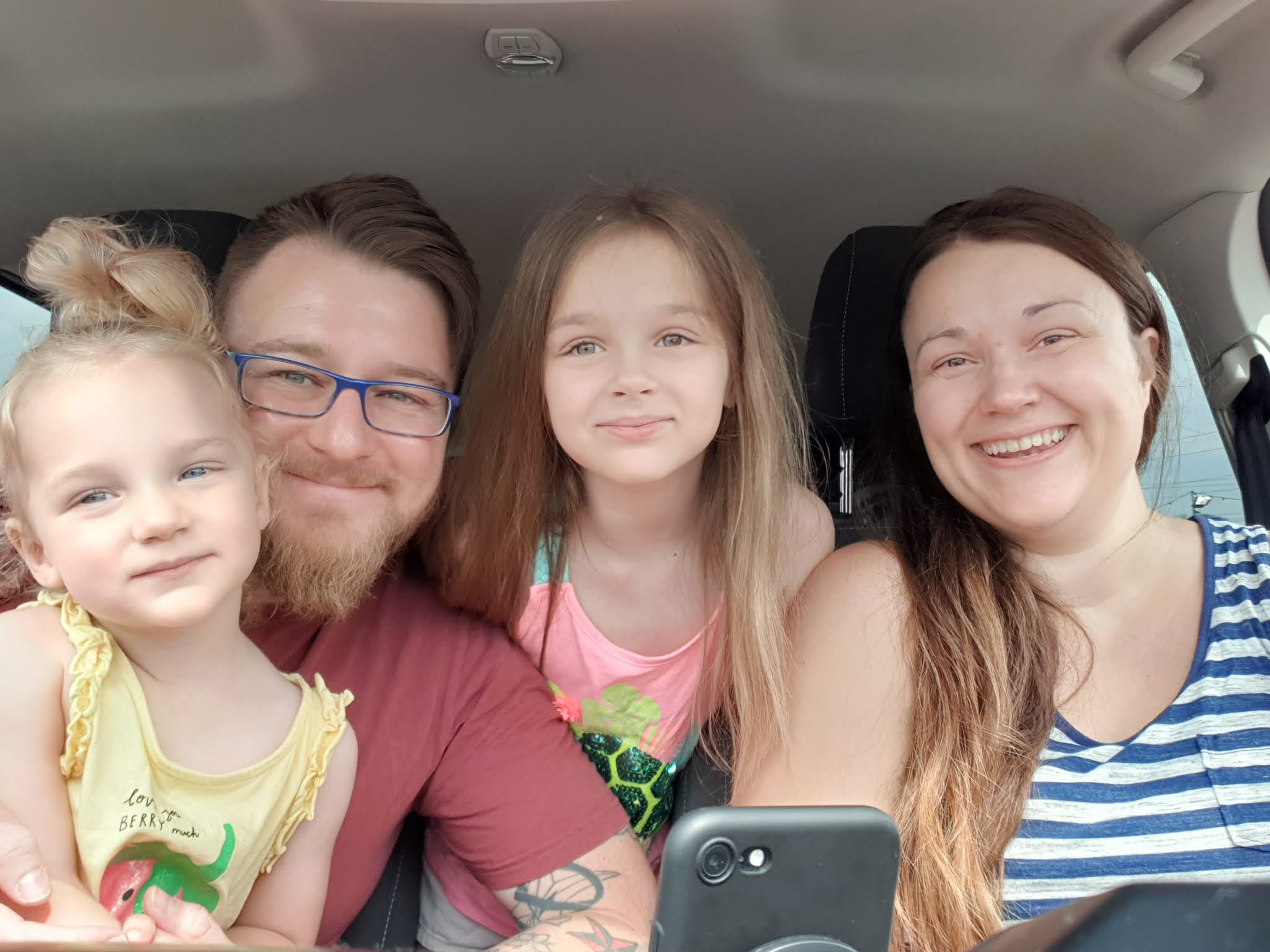 family selfie in the car