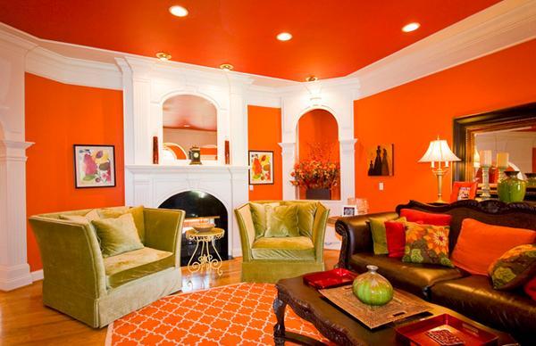 Ruang tamu cantik bertema orange alas dan dindingnya