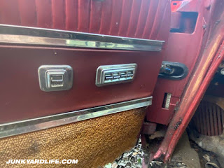 Power windows, power lock switches on door panel of 1962 Pontiac Grand Prix.
