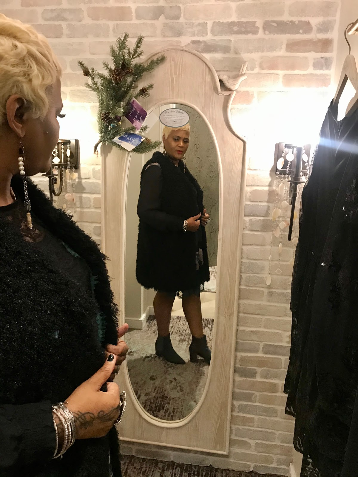 Tangie Bell trying on winter outfits in Altar'd State Dressing Room. Funny Dressing Room Dilemma
