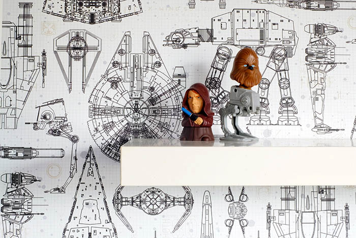 view of Star Wars toys and wallpaper
