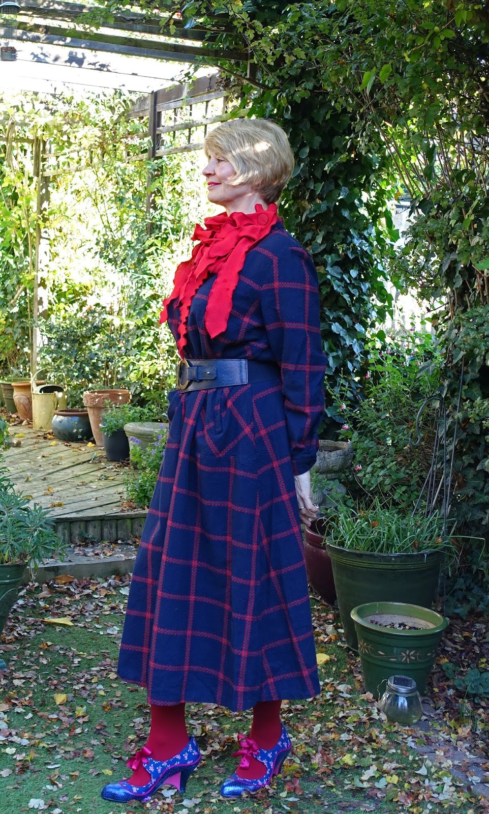 Side view of navy and red check dress from Eva Trends worn by style blogger Is This Mutton?