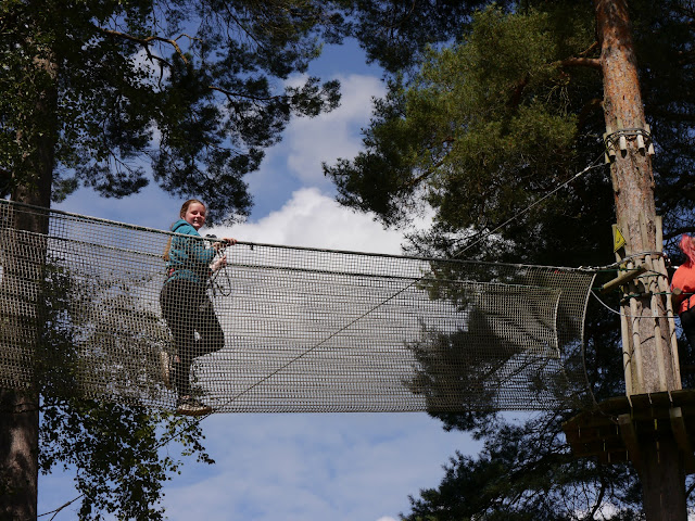 Crossing a rope bridge