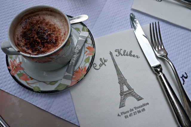 cup of coffee with menu and cutlery
