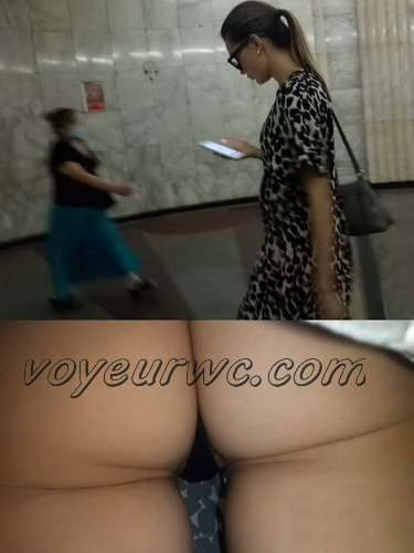 Upskirts N 2968-2977 (Upskirt voyeur videos with girls teasing with their butts on the escalator)