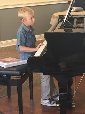 Piano student at his first recital