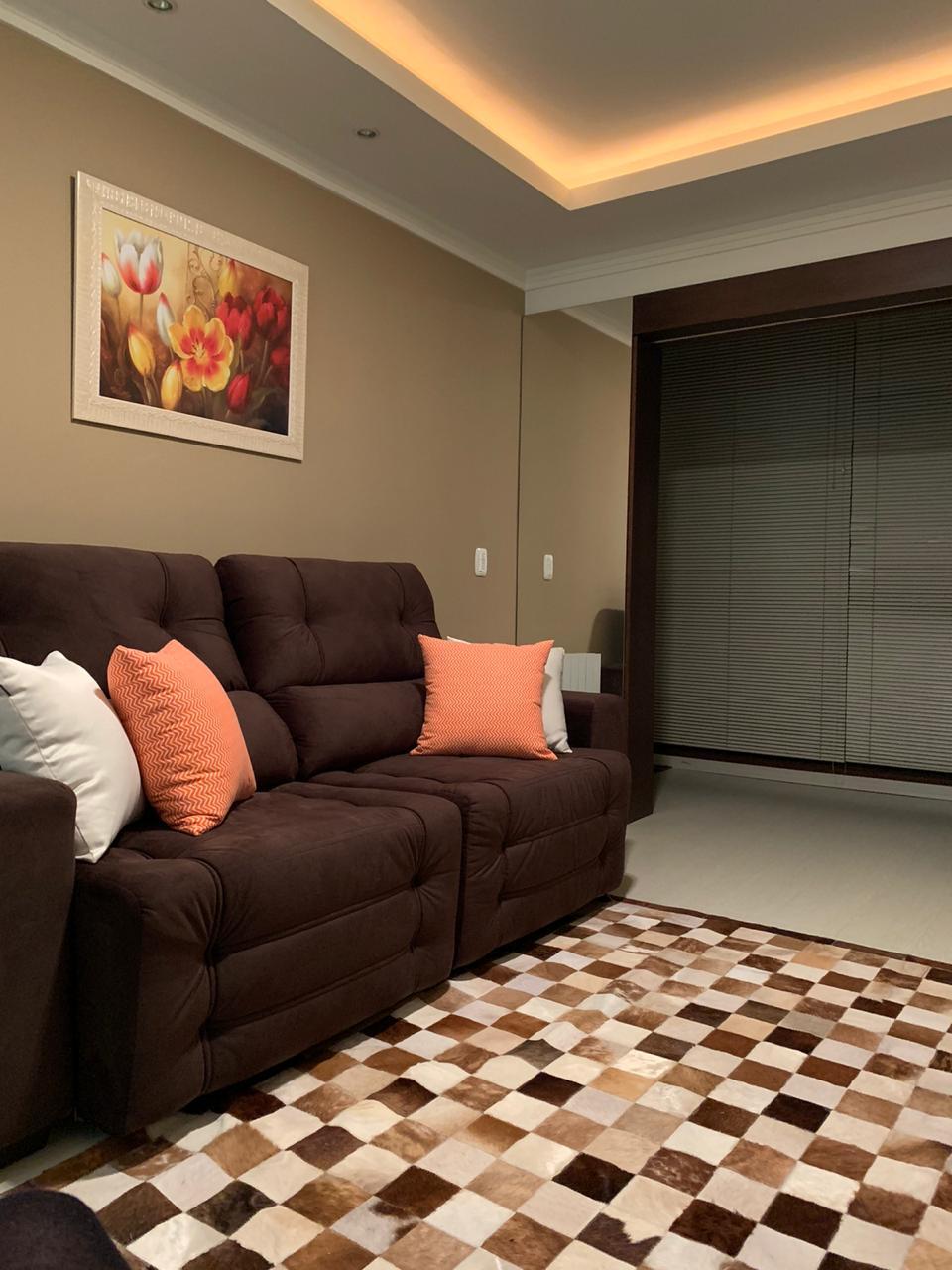 Sala de aconchegante apartamento em Gramado