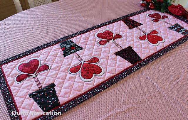 heart flowers on a pink background make a table runner