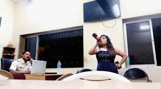 girl drinking inside andheri police station