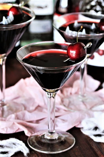 Dracula's Blood Cocktail with Fresh Cherry Garnish Image