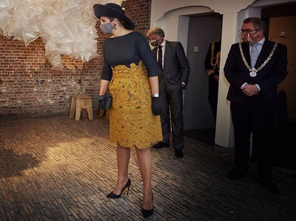 Queen Maxima's outfit is from the fashion house Natan. Queen Maxima wore a yellow lace skirt and gray wool top from Natan. earrings