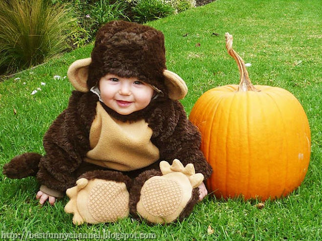Baby dressed as a monkey