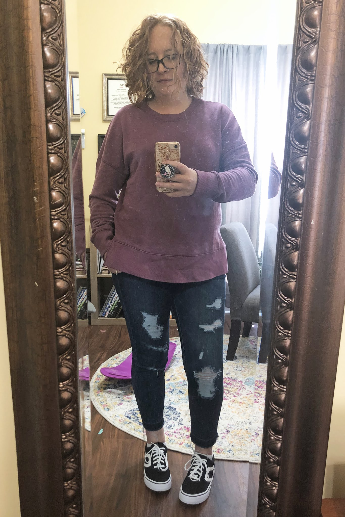 purple sweatshirt ripped jeans