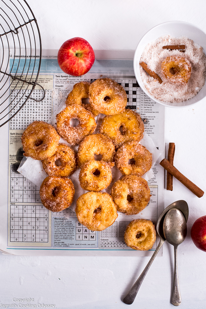 Do not let this autumn go without trying these Air Fryer Apple Ring Doughnuts! These Apple Ring Doughnuts are simple to make but a mouth-watering treat for all. Apple rings are dipped in vegan batter, air fried and coated in cinnamon sugar. These crispy and & delicious fritters are totally plant-based and perfect as a dessert or snack.