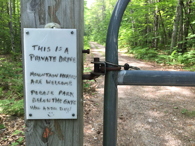 Sign says: This is a private drive. Mountain hikers are welcome. Please park below the gate. Have a nice day.