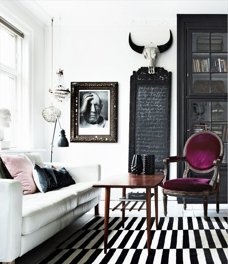 What i really love about interiors that are predominately black and white is when a splash of colour just pops pulls it all together and adds something