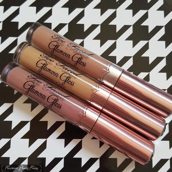3 plumping lipglosses with pink metallic lids on dogtooth background