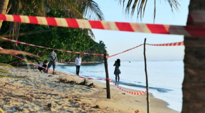 A cordoned section of a beach were two French people were found dead, on August 21, 2016 in Sainte Marie Island. By Sarah Tétaud (AFP/File). Antananarivo (AFP) - Five people were charged and remanded in custody Monday over the murder in August of two young French volunteers on an island off Madagascar, a police official told AFP.