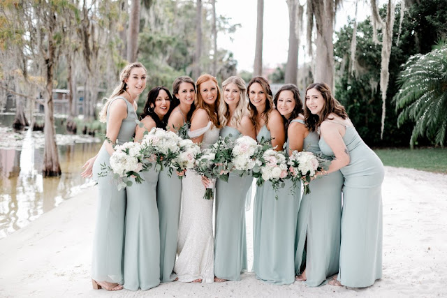 bride with bridesmaids in mint green dresses