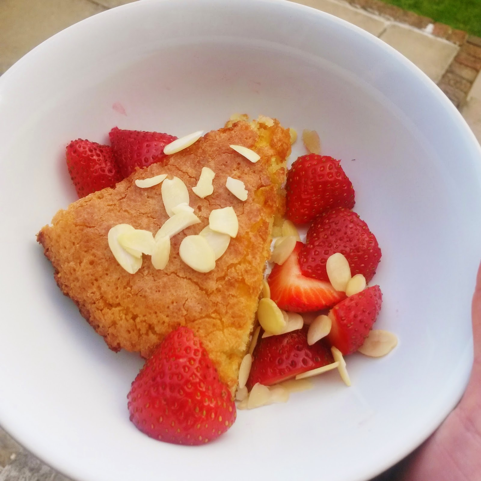 Flourless, gluten free almond and coconut cake with strawberries