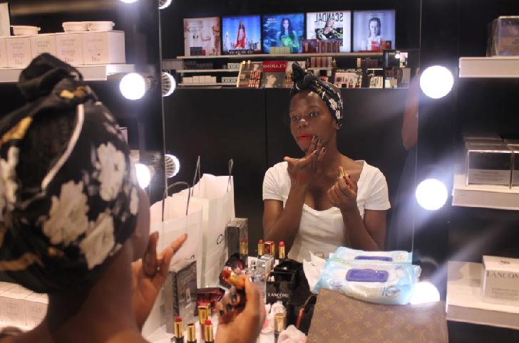 College Girls Applying Makeup