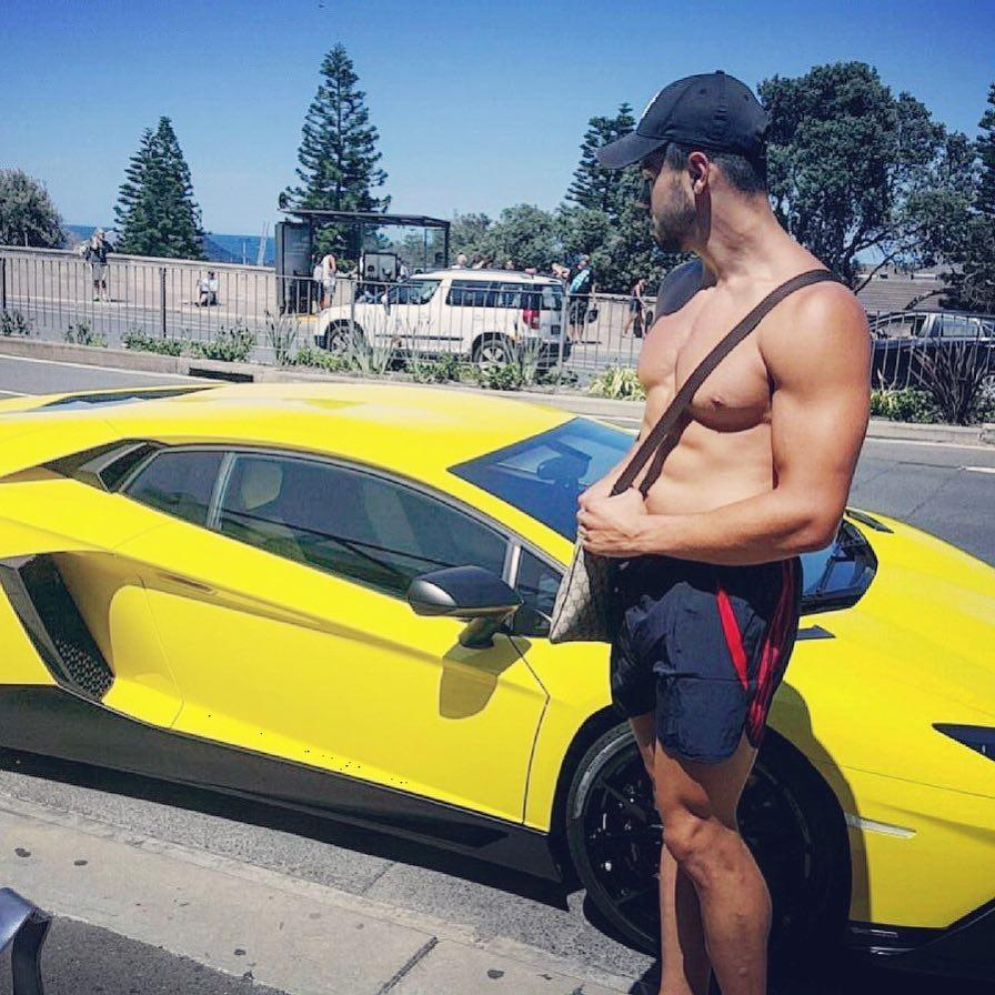 bare-chest-huge-pecs-hunk-yellow-fast-expensive-luxury-ride-race-car