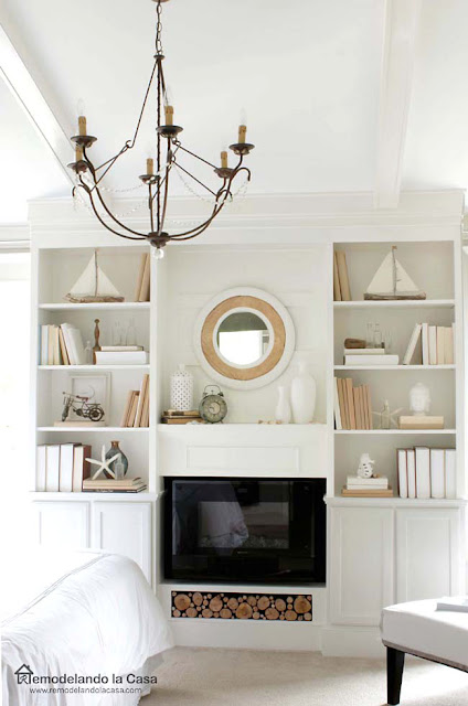 built-ins dressed for summer with wooden ships and starfish, fireplace in the middle
