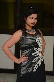Shrisha Dasari in Sleeveless Short Black Dress At Follow Follow U Audio Launch 012.JPG