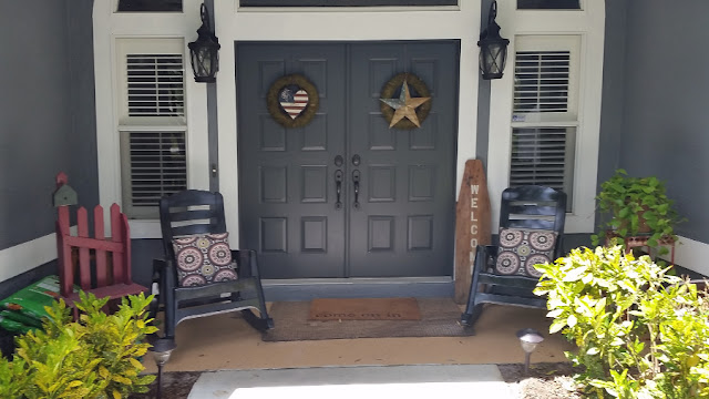 Front porch with newly painted rocking chairs
