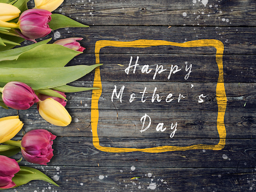 Mother's day on wooden background