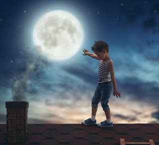 A young boy sleepwalking on a roof.