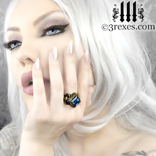 gothic girl model wearing goth medieval wedding ring in bronze with blue topaz