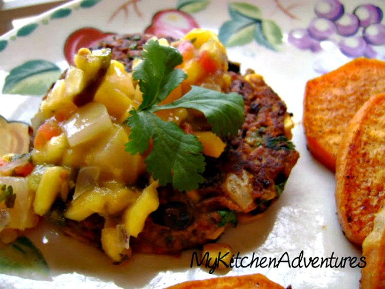 Chipotle Black Bean Burgers with Corn on plate topped with mango salsa