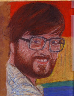 Charcoal portrait of a young man with glasses