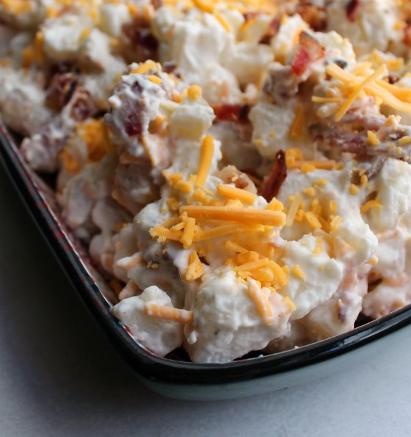 close up of serving bowl filled with cheddar bacon ranch potato salad
